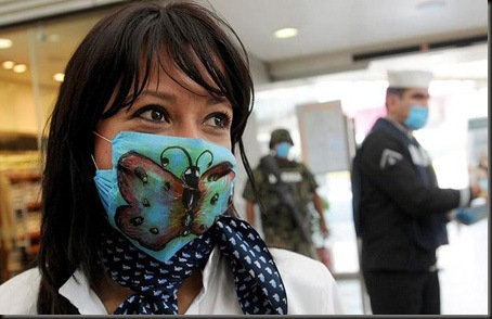 Cristina Trejo, who works at the Mexicana airlines counter, wears a surgical mask with a butterfly painted by herself at  Mexico City's international airport Benito Juarez...Cristina Trejo, who works at the Mexicana airlines counter, wears a surgical mask with a butterfly painted by herself at  Mexico City's international airport Benito Juarez April 27, 2009. Governments around the world rushed to reduce the impact of a possible flu pandemic on Monday, as a swine flu virus that has killed 103 people in Mexico and spread to the United States and Canada also reached Europe. REUTERS/Felipe Leon (MEXICO ENVIRONMENT HEALTH)